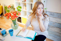 Young businesswoman sitting at desk and working. Beautiful woman and her workplace Stock Image