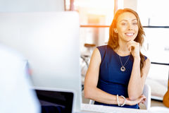 Young businesswoman sitting at desk and working Royalty Free Stock Image