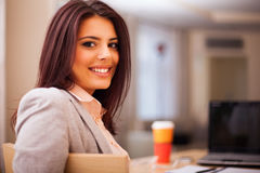 Young businesswoman sitting at desk and working Royalty Free Stock Photography