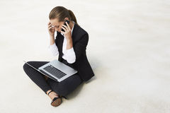 Young businesswoman sitting on floor Stock Photography