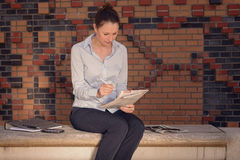 Young businesswoman sitting in a foyer Stock Photo