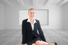 Young businesswoman sitting on ground Stock Image