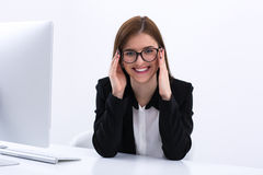 Young businesswoman sitting at her workaplce Royalty Free Stock Photos
