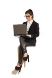 Young businesswoman sitting with laptop Royalty Free Stock Image