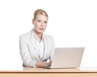 Young businesswoman sitting with laptop, isloated Royalty Free Stock Photo