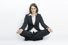 Young businesswoman sitting in lotus position. Stock Images