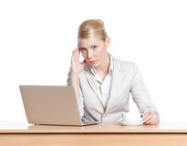 Young businesswoman sitting at a office table with laptop Stock Photo