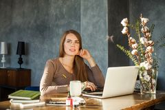 Businesswoman Sitting at Office and Using Laptop Stock Photography