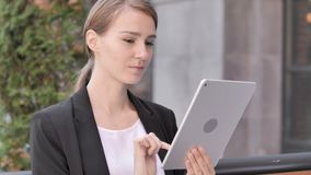 Young Businesswoman Sitting Outdoor and Using Tablet. 4k high quality, 4k high quality stock video