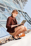 Young businesswoman sitting on stairway Royalty Free Stock Photography