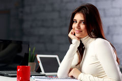 Young businesswoman sitting at the table on her workplace Stock Image