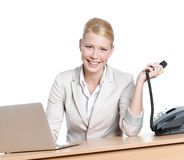 Young businesswoman sitting at a table with phone Royalty Free Stock Photography