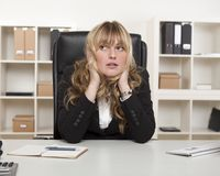 Young businesswoman sitting thinking Stock Photos