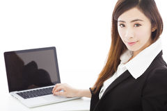 Young businesswoman sitting and using a laptop Royalty Free Stock Photo