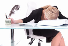 Young businesswoman sleeping on desk. Stock Image