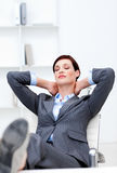 Young Businesswoman sleeping with feet on desk Stock Photo