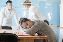 Young businesswoman sleeping during meeting Stock Photography