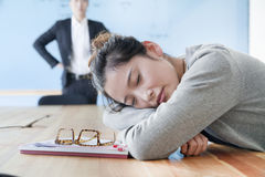 Young businesswoman sleeping during meeting, disappointed Boss looking at her Royalty Free Stock Photography