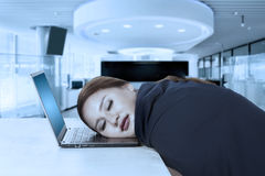 Young businesswoman sleeps on laptop Stock Photography
