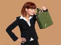 Young businesswoman smelling gas canister Stock Photos