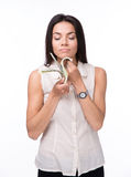 Young businesswoman smelling money Stock Photos