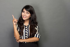 Young businesswoman smile while get an idea Royalty Free Stock Photo