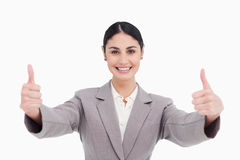 Young businesswoman with a smile giving thumbs up Royalty Free Stock Photography