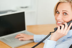 Young businesswoman smiling into camera Stock Images