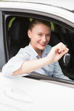 Young businesswoman smiling and holding key Stock Photography