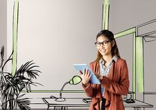 young businesswoman smiling with tablet in front of the blueprint of the new office Royalty Free Stock Photo