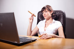 Young businesswoman smoking a cigar Stock Photo