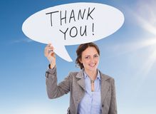 Young businesswoman with speech bubble. Young Happy Businesswoman Holding Speech Bubble With Thank You Text royalty free stock image