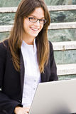 Young businesswoman on stairs Stock Photos