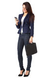 Beautiful businesswoman sending a message on smartphone Stock Photos