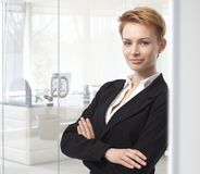 Young businesswoman standing arms crossed Royalty Free Stock Photo