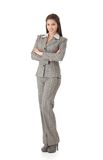 Young businesswoman standing arms crossed smiling Stock Photography