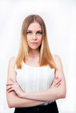 Young businesswoman standing with arms folded Stock Photos
