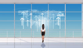 Young businesswoman standing back Stock Images