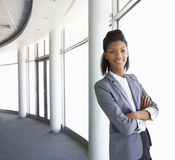 Young Businesswoman Standing In Corridor Of Modern Office Buildi. Ng Royalty Free Stock Image
