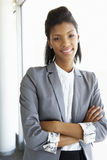 Young Businesswoman Standing In Corridor Of Modern Office Buildi Stock Photos
