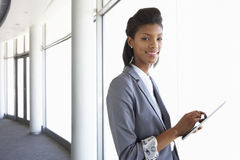 Young Businesswoman Standing In Corridor Of Modern Office Buildi Royalty Free Stock Image