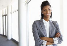 Young Businesswoman Standing In Corridor Of Modern Office Building Stock Photography