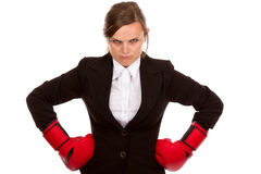 Young businesswoman standing with hands on hips wearing boxing g Royalty Free Stock Images