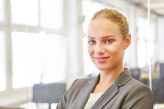 Young businesswoman standing at her office Royalty Free Stock Image