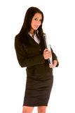 Young businesswoman standing with a laptop stock image