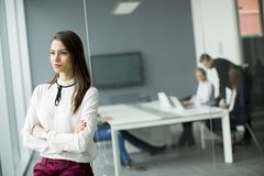 Modern businesswoman standing in modern office Stock Photo