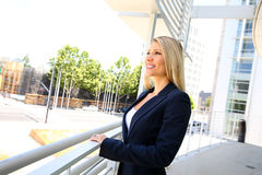 Young businesswoman standing in the office buildings Royalty Free Stock Image