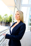 Young businesswoman standing in the office buildings Royalty Free Stock Photo
