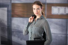 Young businesswoman standing in office lobby Stock Image
