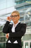 Young businesswoman standing outdoors Stock Photo